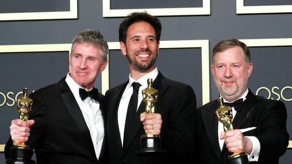 Гийом Рошерон, Грег Батлер и Доминик Туохи на церемонии вручения премии Оскар