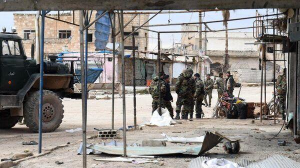 Сирийские военные в населенном пункте в провинции Алеппо