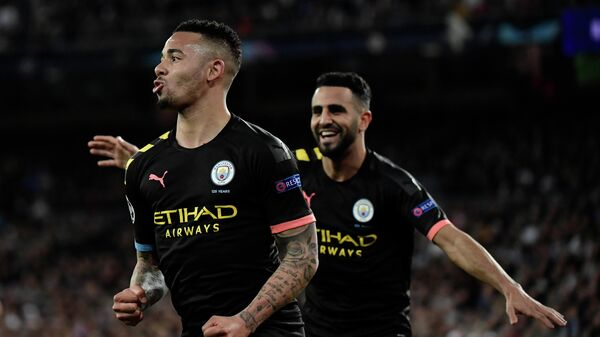 Manchester City's Brazilian striker Gabriel Jesus (L) celebrates his goal during the UEFA Champions League round of 16 first-leg football match between Real Madrid CF and Manchester City at the Santiago Bernabeu stadium in Madrid on February 26, 2020. (Photo by JAVIER SORIANO / AFP)