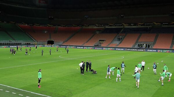 Soccer Football - Europa League - Round of 32 Second Leg - Inter Milan v Ludogorets - San Siro, Milan, Italy - February 27, 2020    Ludogorets players warm up before the match in an empty stadium after fans were not allowed in over coronavirus fears  Emilio Andreoli/Pool via Reuters