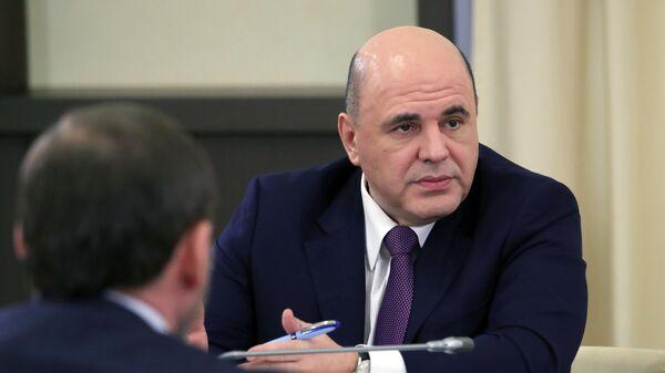 Председатель правительства РФ Михаил Мишустин во время встречи президента РФ Владимира Путина с инвесторами