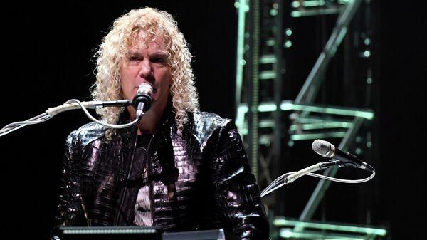 Клавишник и бэк-вокалист американской рок-группы Bon Jovi Дэвид Брайан