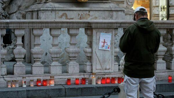 Свечи в память о тех, кто пострадал от коронавируса в Вене, Австрия