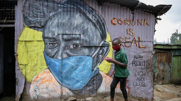 Информационное граффити художников the Mathare Roots, предупреждающее об опасности коронавируса в Найроби, Кения