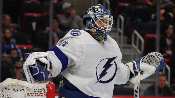 DETROIT, MICHIGAN - DECEMBER 04: Edward Pasquale #80 of the Tampa Bay Lightning looks on while playing the Detroit Red Wings at Little Caesars Arena on December 04, 2018 in Detroit, Michigan. Tampa Bay won the game 6-5 in a shootout.   Gregory Shamus/Getty Images/AFP