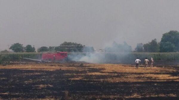 На месте крушения самолета МиГ-29 ВВС Индии в штате Пенджаб. Фотография очевидца