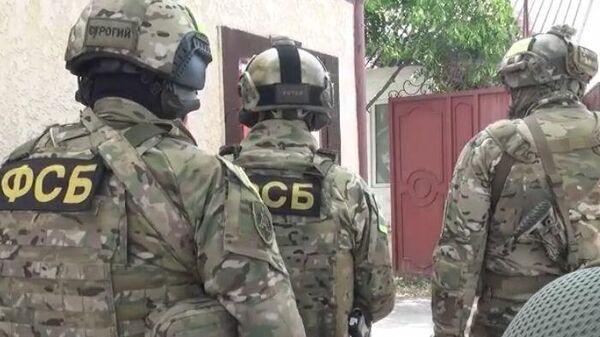 Сотрудники ФСБ во время операции в ингушском городе Сунже по ликвидации двух бандитов, готовивших теракты на территории республики