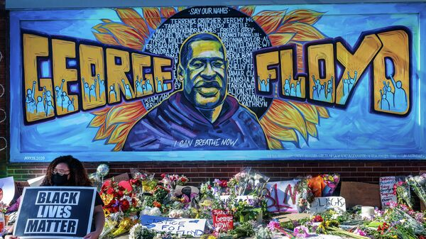 Flowers, signs and balloons are left near a makeshift memorial to George Floyd near the spot where he died while in custody of the Minneapolis police, on May 29, 2020 in Minneapolis, Minnesota. - Demonstrations are being held across the US after George Floyd died in police custody on May 25. (Photo by Kerem Yucel / AFP)