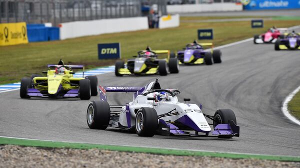 British motor racing driver Jamie Chadwick (R) leads to win in her Tatuus F3 T-318 ahead of compatriot Alice Powell and Marta Garcia during the W Series motor racing event on the Hockenheimring, south-western Germany on May 4, 2019. (Photo by Hasan Bratic / dpa / AFP) / Germany OUT