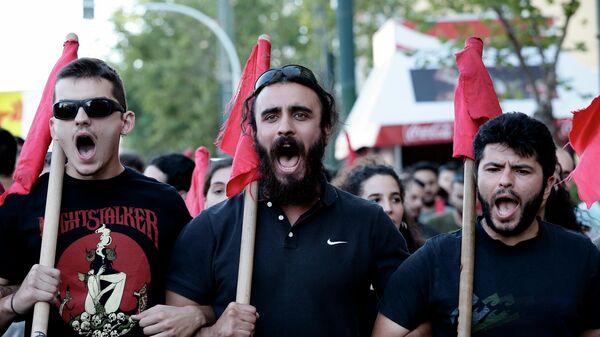 Участники акции в Афинах против запрета на проведние митингов