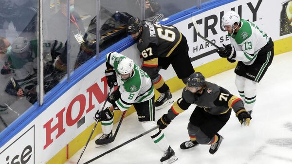 Sep 14, 2020; Edmonton, Alberta, CAN; Vegas Golden Knights center William Karlsson (71) reaches for the puck on Dallas Stars defenseman Andrej Sekera (5) during the second period in game five of the second round of the 2020 Stanley Cup Playoffs at Rogers Place. Mandatory Credit: Gerry Thomas-USA TODAY Sports