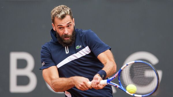 Benoit Paire of France returns the ball to Casper Ruud of Norway during their first round match of the ATP-Tour German Open tennis tournament at the stadium Am Rothenbaum in Hamburg, northern Germany, on September 23, 2020. - Paire gave up in the second set. (Photo by Daniel Bockwoldt / dpa / AFP) / Germany OUT