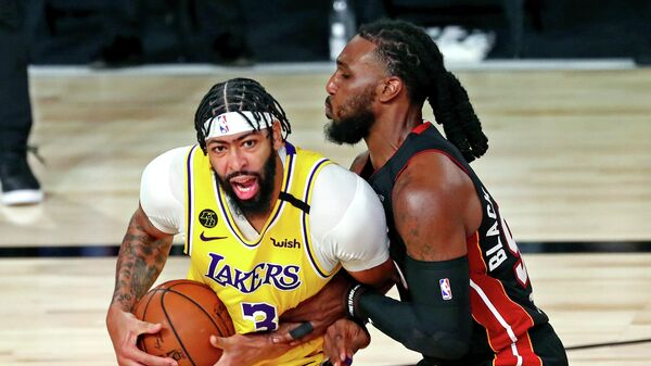 Sep 30, 2020; Orlando, Florida, USA; Los Angeles Lakers forward Anthony Davis (3) drives to the basket against Miami Heat forward Jae Crowder (99) during the third quarter in game one of the 2020 NBA Finals at AdventHealth Arena. Mandatory Credit: Kim Klement-USA TODAY Sports