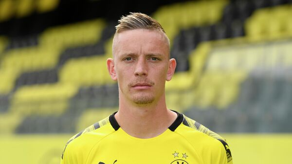 Dortmund's German forward Marius Wolf poses for a photo during the presentation of Borussia Dortmund's squad for the upcoming first Bundesliga season at their training ground in Dortmund, western Germany, on August 6, 2019. (Photo by INA FASSBENDER / POOL / AFP)