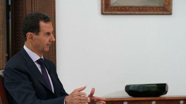 Президент Сирийской Арабской Республики Башар Асад во время интервью информационному агентству РИА Новости