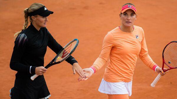 Теннисистки Тимя Бабош и Кристина Младенович на Ролан Гаррос