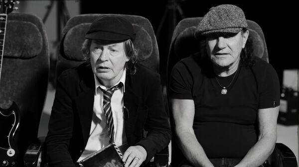 Музыканты группы AC/DC Ангус Янг и Брайан Джонсон