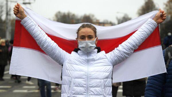 Участница несанкционированной акции белорусской оппозиции Марш смелых в Минске