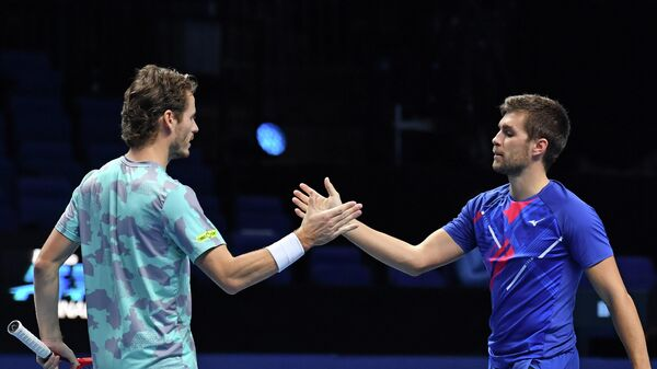 Croatia's Nikola Mektic (R) and Netherlands' Wesley Koolhof (L) celebrate after beating USA's Rajeev Ram and Britain's Joe Salisbury in their men's doubles round-robin match on day three of the ATP World Tour Finals tennis tournament at the O2 Arena in London on November 17, 2020. (Photo by Glyn KIRK / AFP)