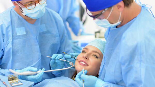Пациент в кабинете стоматолога