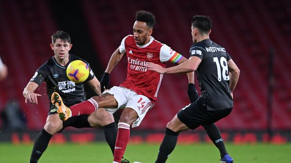 Arsenal's Gabonese striker Pierre-Emerick Aubameyang (C) controls the ball in front of Burnley's English defender James Tarkowski (L) and Burnley's English midfielder Ashley Westwood (R) during the English Premier League football match between Arsenal and Burnley at the Emirates Stadium in London on December 13, 2020. (Photo by Laurence Griffiths / POOL / AFP) / RESTRICTED TO EDITORIAL USE. No use with unauthorized audio, video, data, fixture lists, club/league logos or 'live' services. Online in-match use limited to 120 images. An additional 40 images may be used in extra time. No video emulation. Social media in-match use limited to 120 images. An additional 40 images may be used in extra time. No use in betting publications, games or single club/league/player publications. /