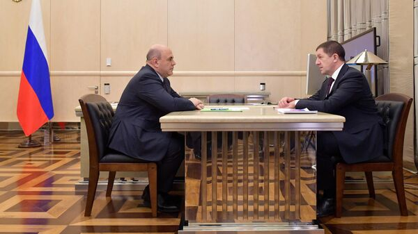 Председатель правительства РФ Михаил Мишустин и президент ПАО Ростелеком Михаил Осиевский