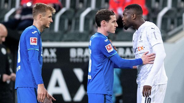 Soccer Football - Bundesliga - Borussia Moenchengladbach v TSG 1899 Hoffenheim - Borussia-Park, Moenchengladbach, Germany - December 19, 2020 Borussia Moenchengladbach's Marcus Thuram and TSG 1899 Hoffenheim's Stefan Posch clash Pool via REUTERS/Marius Becker DFL regulations prohibit any use of photographs as image sequences and/or quasi-video.