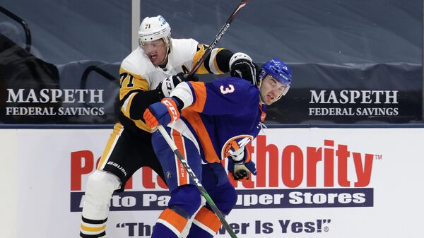 UNIONDALE, NEW YORK - FEBRUARY 06: Evgeni Malkin #71 of the Pittsburgh Penguins attempts to get past Adam Pelech #3 of the New York Islanders during the first period at the Nassau Coliseum on February 06, 2021 in Uniondale, New York.   Bruce Bennett/Getty Images/AFP