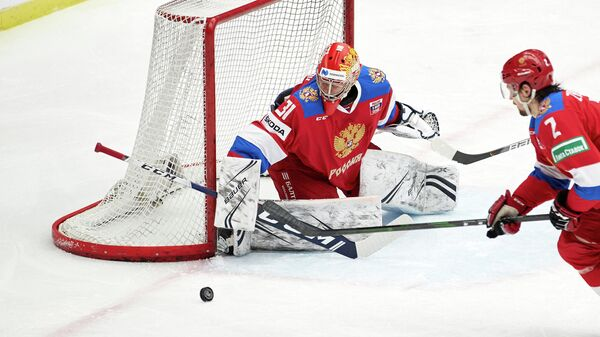 Russia's goalkeeper Alexander Samonov eyes the puck during the Beijer Hockey Games (Euro Hockey Tour) icehockey match between Russia and Finland in Malmo, Sweden, on February 11, 2021. (Photo by Anders Bjuro / TT News Agency / AFP) / Sweden OUT