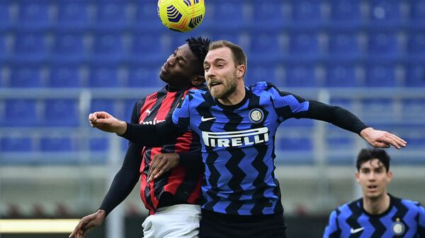 AC Milan's Portuguese forward Rafael Leao (L) and Inter Milan's Danish midfielder Christian Eriksen go for a header during the Italian Serie A football match AC Milan vs Inter Milan on February 21, 2021 at the San Siro stadium in Milan. (Photo by MIGUEL MEDINA / AFP)
