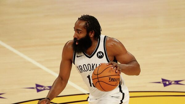 LOS ANGELES, CALIFORNIA - FEBRUARY 18: James Harden #13 of the Brooklyn Nets handles the ball during the third quarter against the Los Angeles Lakers at Staples Center on February 18, 2021 in Los Angeles, California. NOTE TO USER: User expressly acknowledges and agrees that, by downloading and or using this photograph, User is consenting to the terms and conditions of the Getty Images License Agreement.   Katelyn Mulcahy/Getty Images/AFP (Photo by Katelyn Mulcahy / GETTY IMAGES NORTH AMERICA / AFP)
