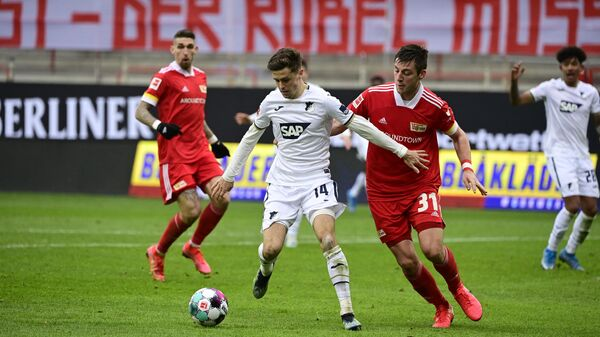 Hoffenheim's Austrian midfielder Christoph Baumgartner (C-L) and Union Berlin's German defender Robin Knoche (C-R) vie for the ball during the German first division Bundesliga football match 1 FC Union Berlin v  TSG 1899 Hoffenheim in Berlin, Germany, on February 28, 2021. (Photo by Tobias SCHWARZ / various sources / AFP) / DFL REGULATIONS PROHIBIT ANY USE OF PHOTOGRAPHS AS IMAGE SEQUENCES AND/OR QUASI-VIDEO
