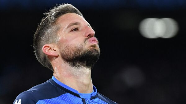 Napoli's Belgian forward Dries Mertens reacts after scoring a penalty during the UEFA Champions League Group E football match Napoli vs Genk on December 10, 2019 at the San Paolo stadium in Naples. (Photo by Tiziana FABI / AFP)