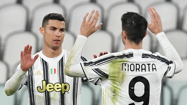 Juventus' Portuguese forward Cristiano Ronaldo celebrates after scoring the third goal during the Italian Serie A football match Juventus vs Spezia on March 02, 2021 at the Juventus stadium in Turin. (Photo by Isabella BONOTTO / AFP)