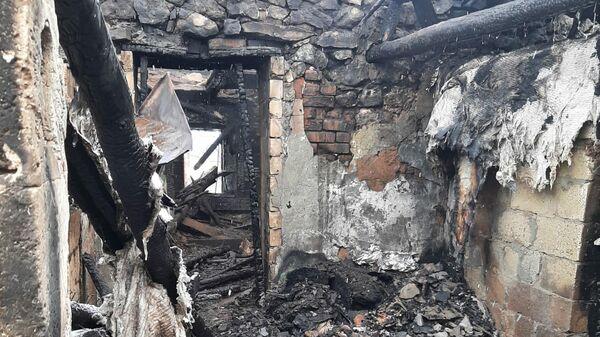 Коридор сгоревшего дома