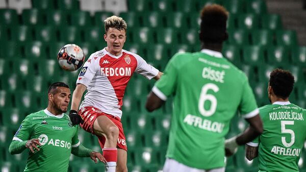 Saint-Etienne's Peruvian defender Miguel Trauco (L) fights for the ball with Monaco's Russian midfielder Aleksandr Golovin (R) during the French L1 football match, AS Saint-Etienne (ASSE) vs AS Moncao (ASM) on March 19, 2021 at Geoffroy Guichard stadium in Saint-Etienne. (Photo by JEFF PACHOUD / AFP)