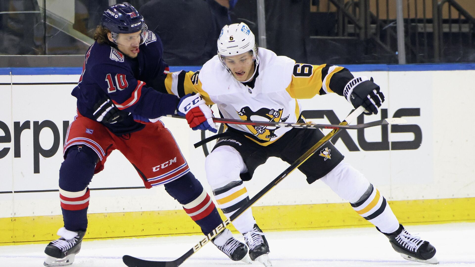 Apr 8, 2021; New York, New York, USA; Pittsburgh Penguins defenseman John Marino (6) plays for the puck against New York Rangers left wing Artemi Panarin (10) during the first period at Madison Square Garden. Mandatory Credit:  Bruce Bennett/Pool Photo-USA TODAY Sports - РИА Новости, 1920, 10.04.2021