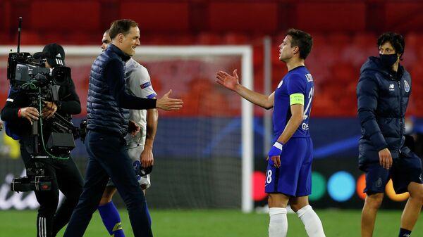 Главный тренер Челси Томас Тухель (слева)  и Сесар Аспиликуэта
