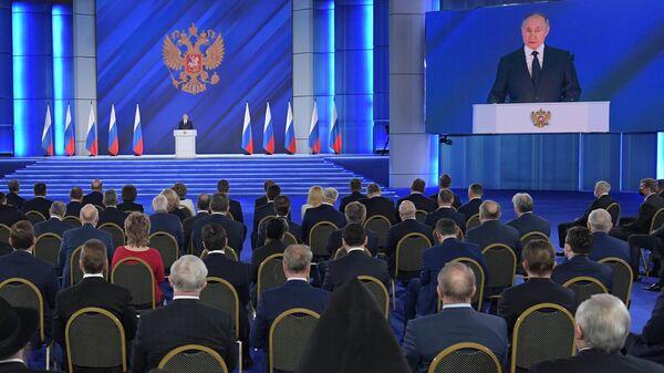 Президент РФ Владимир Путин во время выступления с ежегодным посланием Федеральному Собранию