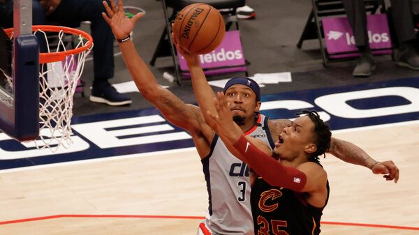 Apr 25, 2021; Washington, District of Columbia, USA; Washington Wizards guard Bradley Beal (3) prepares to block a shot by Cleveland Cavaliers forward Isaac Okoro (35) in the fourth quarter at Capital One Arena. Mandatory Credit: Geoff Burke-USA TODAY Sports