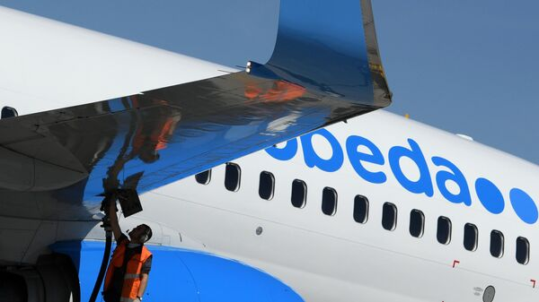 Самолёт Boeing 737-800 авиакомпании Победа в аэропорту Шереметьево