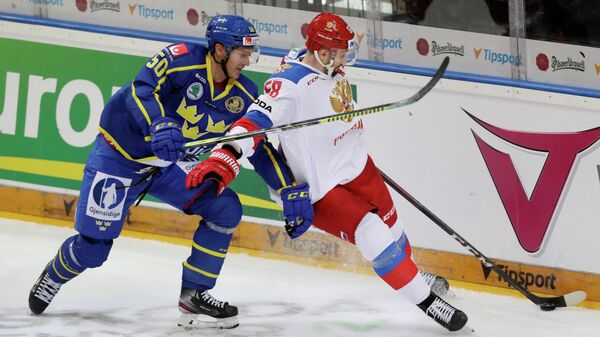Ice Hockey - Euro Hockey Tour - Carlson Hockey Games - Sweden v Russia - O2 Arena, Prague, Czech Republic - May 12, 2021 Russia's Anton Slepyshev in action with Sweden's Viktor Loov REUTERS/David W Cerny