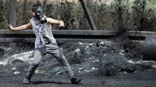 Столкновения между израильской полицией и палестинцами на Западном берегу
