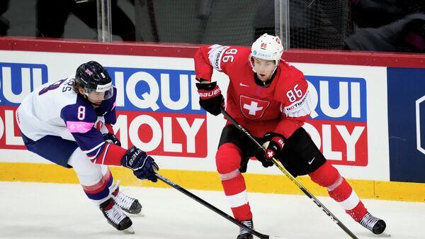 Матч ЧМ по хоккею между сборными Швейцарии и Великобритании