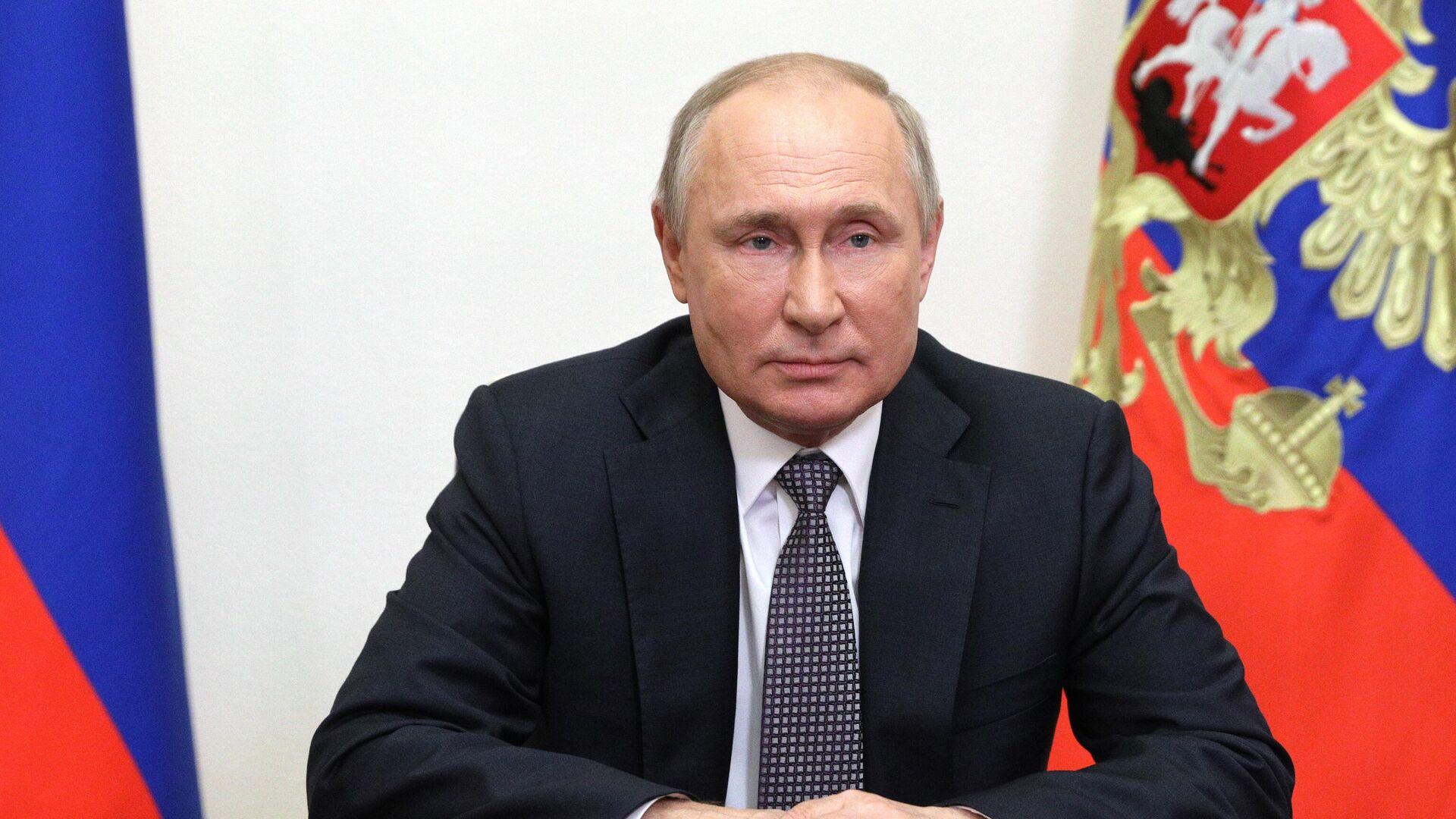 Президент РФ Владимир Путин выступает с видеообращением к участникам и гостям IX Московской конференции по международной безопасности - РИА Новости, 1920, 23.06.2021