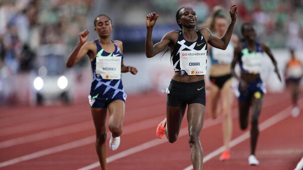 Hellen OBIRI from Kenya (R) and Fantu WORKU from Ethiopia compete in the 5000M women final at the Diamond League track and field meeting in Oslo on July 1, 2021. (Photo by STR / Diamond League AG)