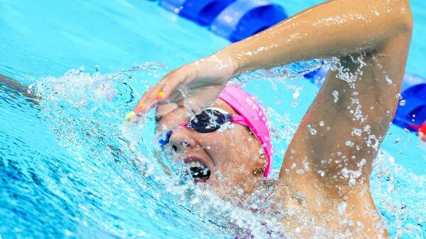Юлия Ефимова на тренировке в олимпийском бассейне Токио