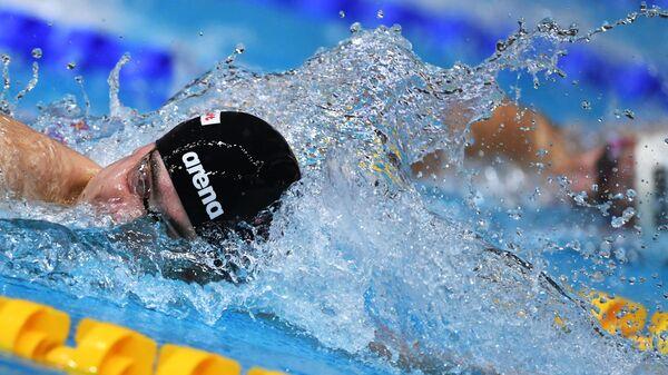 Михаил Довгалюк на дистанции 200 м вольным стилем  в финальном заплыве среди мужчин на чемпионате России по плаванию в Казани.