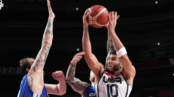 USA's Jayson Tatum (R) goes to the basket past Czech Republic's Ondrej Balvin (L) in the men's preliminary round group A basketball match between USA and Czech Republic during the Tokyo 2020 Olympic Games at the Saitama Super Arena in Saitama on July 31, 2021. (Photo by Aris MESSINIS / AFP)