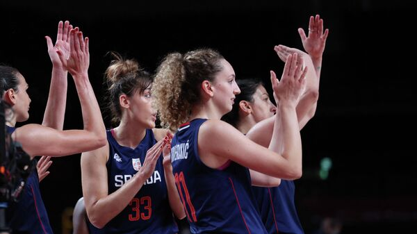 Serbian players celebrate their win in the women's preliminary round group A basketball match between South Korea and Serbia during the Tokyo 2020 Olympic Games at the Saitama Super Arena in Saitama on August 1, 2021. (Photo by Thomas COEX / AFP)